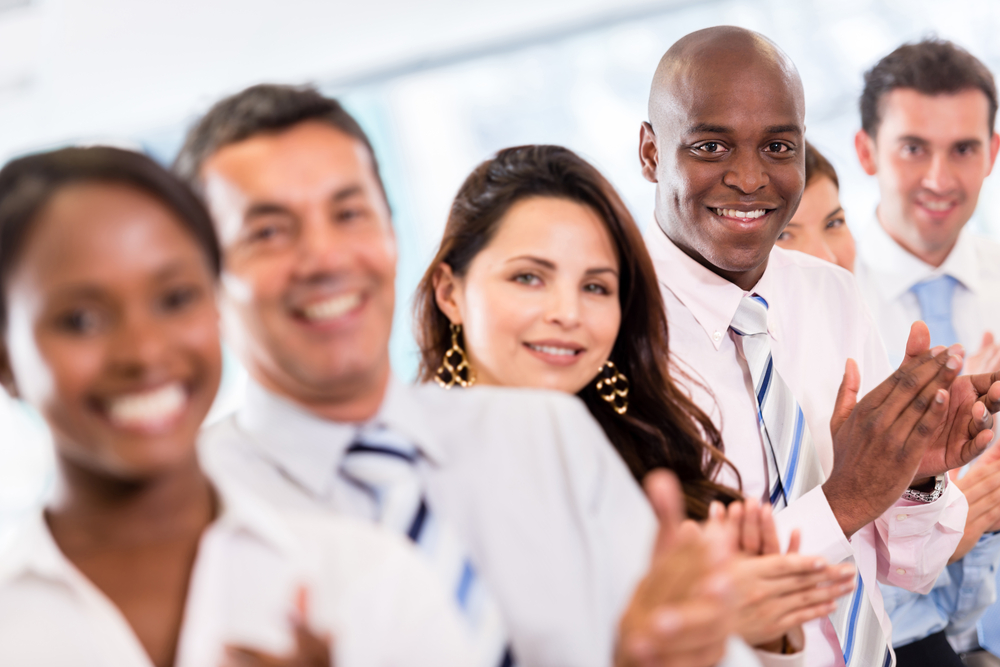 Successful business group applauding after a presentation