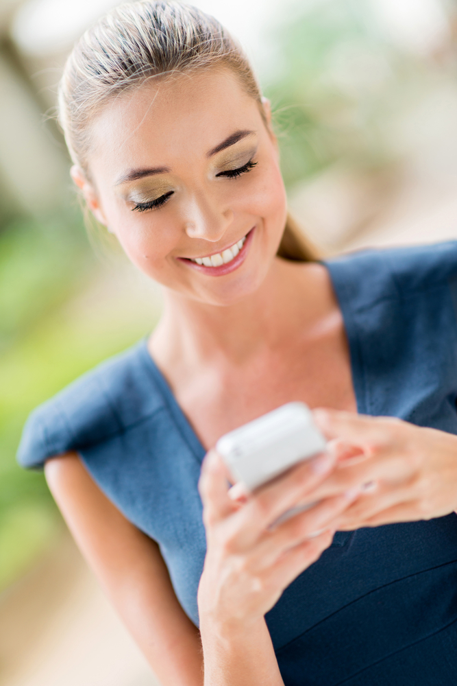 Business woman using app on a smart phone